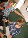 Isabele from s/v Wasabi gives a guitar lesson to Cole in Panama City
