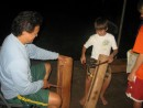 Cole learning the local drums at a residence in Fatu Hiva, Marquesas