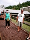 Cheryl and Tom helping to dry the cocoa beans in traditional way