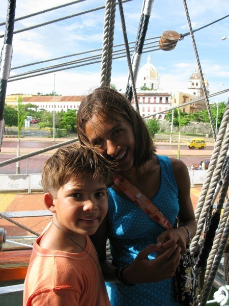 Cole and Cammi w/old town in background, while on tall ship, Gloria in Cartagena