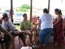 Jesse and Tom getting served appetizers by the ladies - Upolu, Samoa