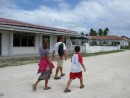 Walking through the village in Niuatoputapu, Tonga