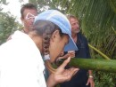 Cammi enjoys bamboo water at peak of volcano in  Tafahi, Tonga