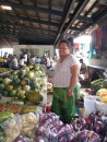 Woman selling me veggies, fruits and cooking tips in Apia, Samoa
