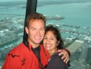 Tom and Monique in Sky Tower w/Viaduct Marina in background - happy to have made it all the way to NZ!