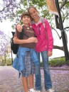 Cam and Cole under the jacaranda trees