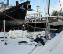 Tom on the tramp w/the shrinkwrap while still on Dockwise Yacht Transport in Ft Lauderdale