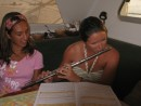 Cammi learning the flute from Marge on her birthday