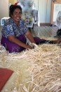 Maria - hand weaving a large floor mat from dried Pandanis leaves
