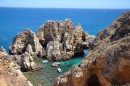 Spectacular coast line here.  All kinds of boats travel too and from these grottos full of people out for day trips.