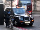 Not sure if the cyclist will care about the ticket - notice the black taxi in the background - all London cabs are like that
