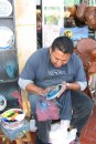 New level of finger painting at Ensenada!: Ensenada: Finger painter made beautiful paintings on plates.