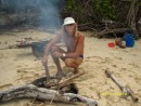 Claude grilling freshly caught fish on the beach