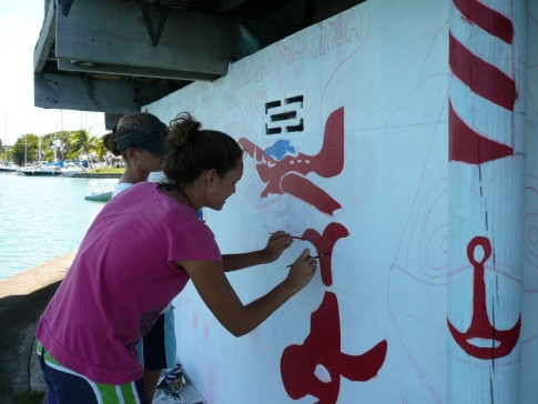 mariska and rochelle painting the mural at the marina