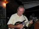 John strumming away on his mandolin