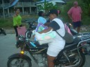 Taking the baby home after the softball game.  This was not an uncommon sight to see infants on a motorcycle