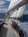 28 knots on the nose.  We are close hauled with staysail and double reefed main.  She is smoking!