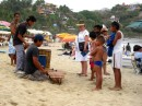local young men playing music on the beach