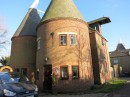 An oast house, where hops was dried, converted to homes