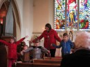 Margaret leads Sunday worship with the children.