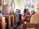Christmas service with the Vicar, Tim and women who brought a gift to share with the congregation