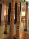 Burial sticks in the Victoria Gallery.  Each holds the bones of a relative and is painted with their story