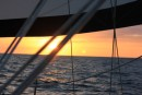 Sailing in the North Atlantic as the sun sets.