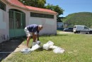 Filling our water containers in Deshaies, Guadaloupe. We drink it straight from the hose and hope for the best.....