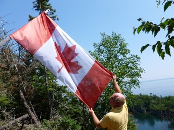 And the Captain honoring the Canadian flag atop Thompson Island.