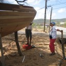 Alice kabitzin with one of the boat builders as he preps the transum for sanding.