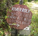 We drove our rental car up a dirt road for about 2 miles just to find this!!...  Things are truly different here, this sign, leaning against a pile of cinder blocks was all there was to find Riverrock Falls.  if the sign was a disappointment, guess what.... so were the falls.  Oh well, ya win some and you loose some, we continued on.
