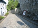 Alice holding up the fortress wall.  Winding cobble-stone street from the upper city to the lower.