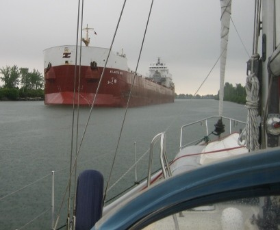 After anchoring for the night just off the channel we awoke to meeting this lake freighter in a narrow portion of the river.