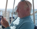 The captain checking the internet some 15 or so miles offshore, amazing, so easy