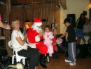 Santa giving gifts to kids. A total of 462 gifts were given out.