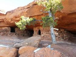 These structures were used to stored food and water for travelers to use. They were well hidden to avoid pilfering.