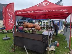 Roasting a whole pig on Bastille Day