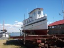 An early tugboat used to push the sailing s=vessels in port