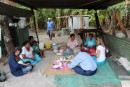 After presenting our gift of kava to the chief we were introduced to some of the families who promptly began to feed us.