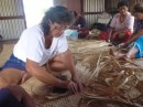 Michelle learning a new trade.  On Mondays the village women get together to weave new mats for flooring or send to the craft market in Suva.