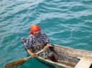 Kuna women in her dugout canoe