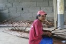 The women still weave palm fronds together for roofs and walls.