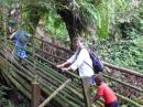 Crossing a bamboo bridge on the trek to Millenium Cave.  The local village owns the land and the cave.  Tour proceeds benefit the school.