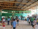"The main classroom building and ""auditorium"".  Every child that comes here has to finish all 6 grades,  no skipping ahead. Sometimes a child is 10 or 12 before they get their first opportunity for a formal education.  After 6th grade they go to what they refer to as college,  which is like our junior high.  They usually have to find sponsors to pay for this,  which costs up to $500/year.  A very lot of money for them."