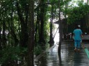 Walkway to the boys dorm,  built over the river.  They can often be seen jumping off the 2nd floor balcony into the river