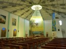 Inside the catholic church,  the main religion in the Galapagos.  Simple, tasteful, most of the statues are carved from wood by  local artists