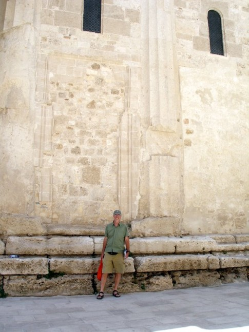 Rick outside the cathedral walls