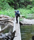 Alison is glad a good log bridge spans the Deception Creek near the end of the trail.