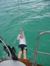 Bahamas 2006 - 028: Swinging from the stern arch at Crab Cay, where we ending up after sailing the night.