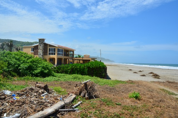 Nice home on the beach - without barb-wire!  i had to take a picture!